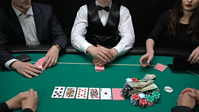 Poker players putting dollars and watch on casino table, raising bet, bluff